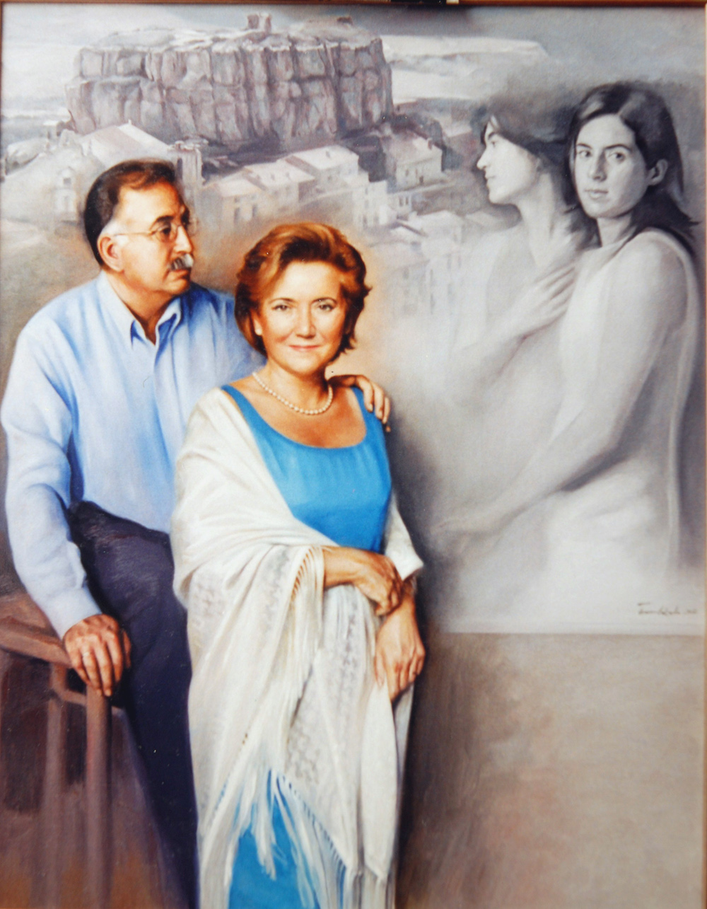 Couple with their daughters as background