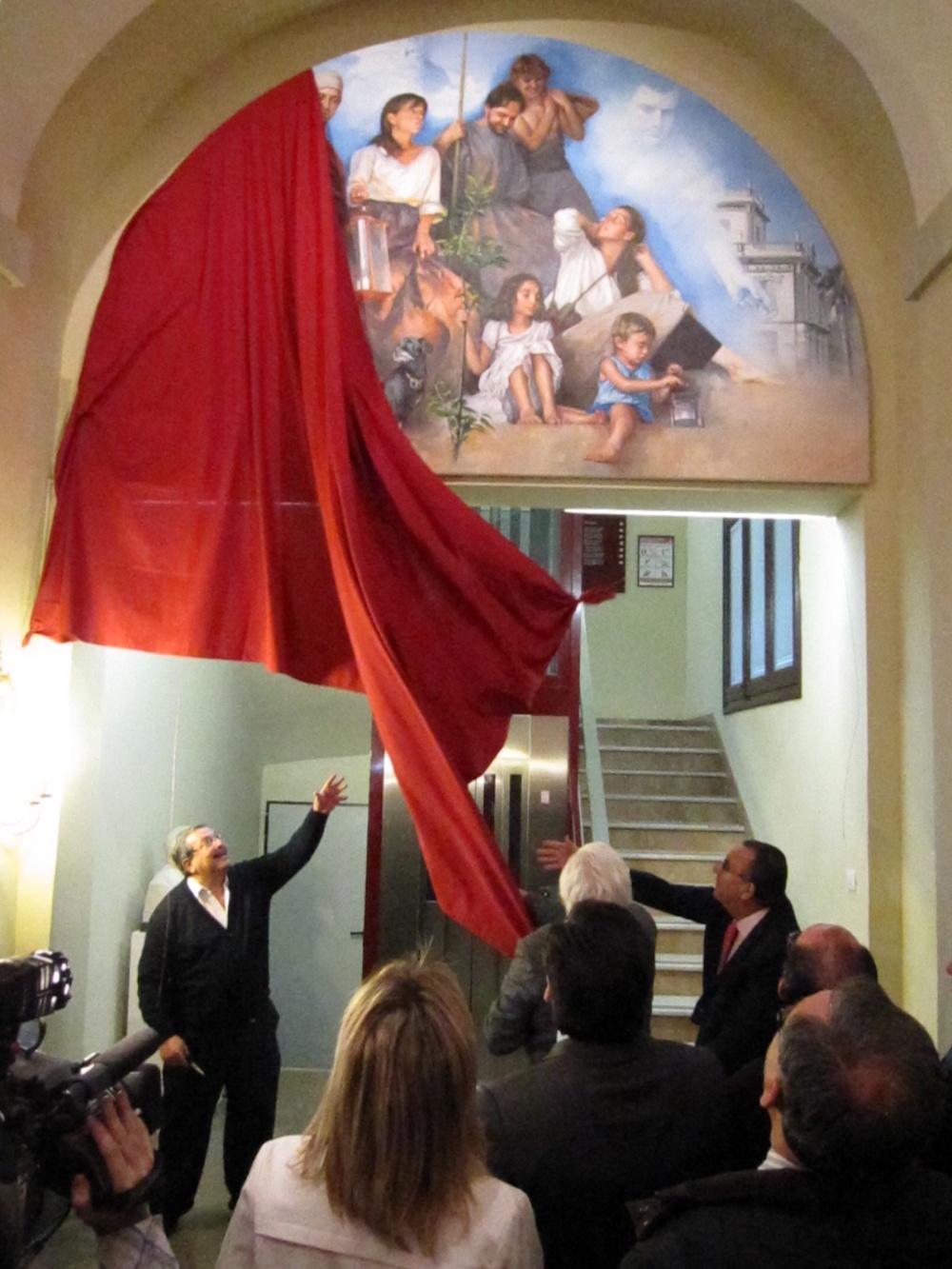 Se trata de un luneto que reproduce el ábside de la iglesia de Burriana, y el ayuntamiento de Les Alqueries, primera y última localidades fundadas.